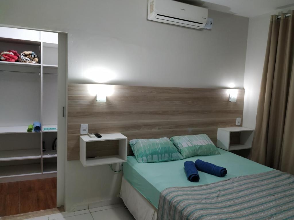 A bed or beds in a room at Solar Recanto da Águia