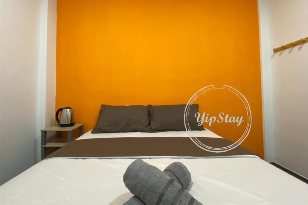 A bed or beds in a room at YipStay