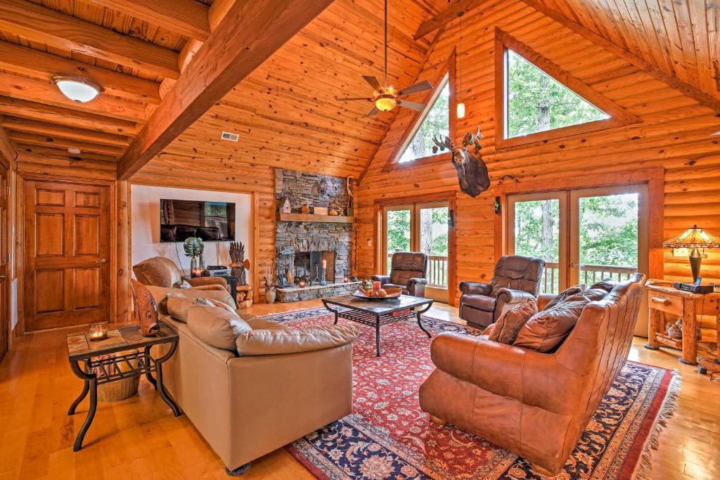 A seating area at Large Lavonia Lakefront Log Cabin with Boat Slip