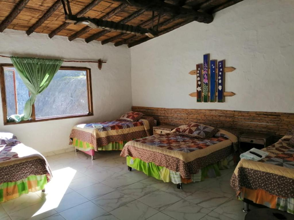 A bed or beds in a room at HOTEL MONTE VERDE