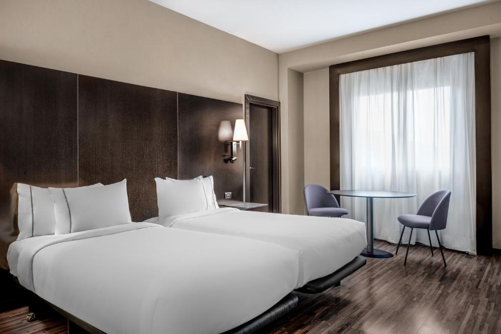 A bed or beds in a room at AC Hotel by Marriott Oviedo Forum