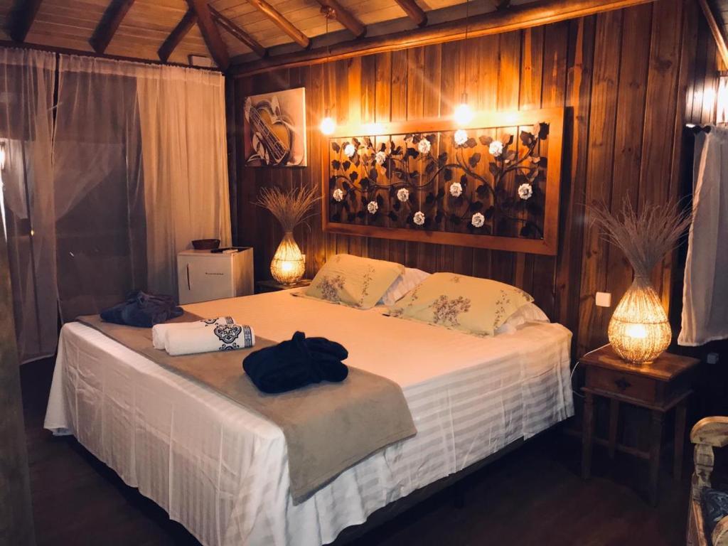Cama ou camas em um quarto em Pousada de Charme Emirados
