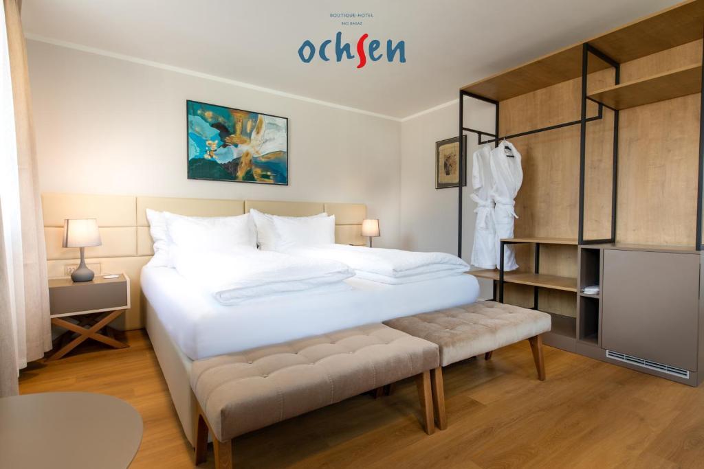 Ein Bett oder Betten in einem Zimmer der Unterkunft Boutique Hotel OchSen