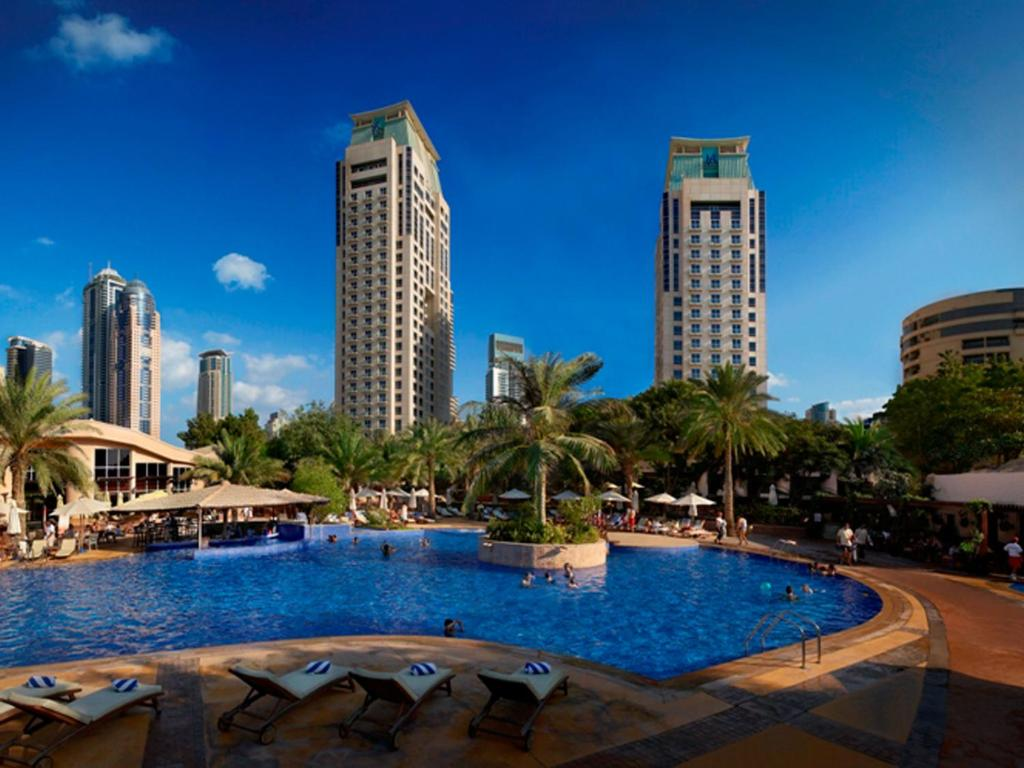 The swimming pool at or near Habtoor Grand Resort, Autograph Collection
