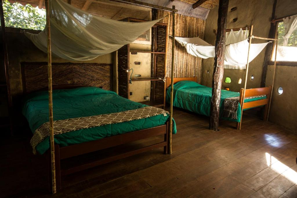 A bed or beds in a room at Chirapa Manta Amazon Lodge