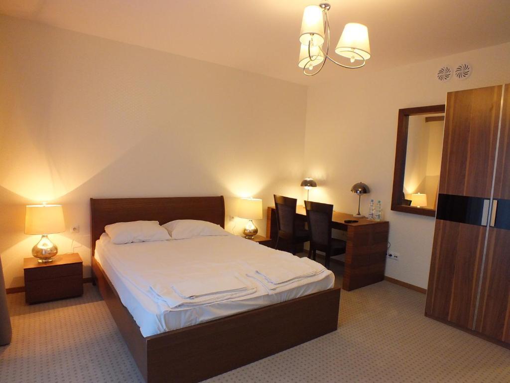 Łóżko lub łóżka w pokoju w obiekcie Hotel Eco