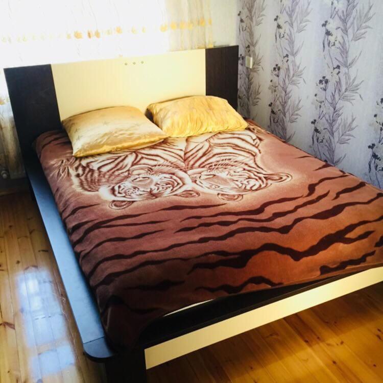 Cama ou camas em um quarto em Qafqaz Yellow Villa