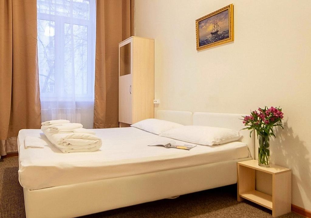 Кровать или кровати в номере Хостел Маяк