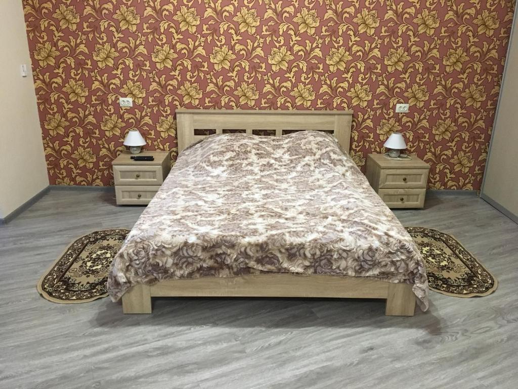 Кровать или кровати в номере Apartment on Leningradskaya 81