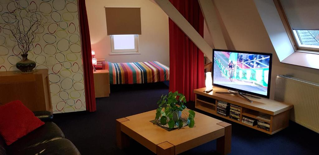 Een TV en/of entertainmentcenter bij Apartment Campinor