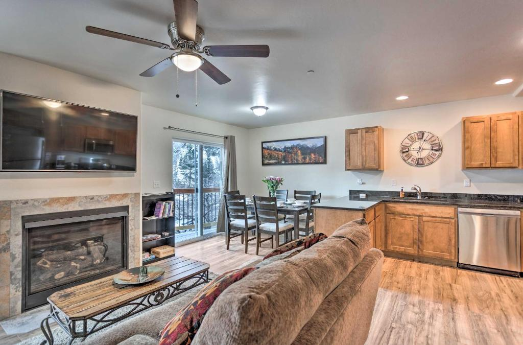 A seating area at Modern Townhome with Deck Steps to Ouray Hot Springs
