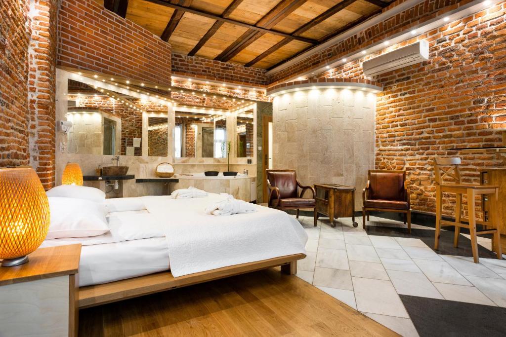 Cama o camas de una habitación en Aparthotel Stare Miasto
