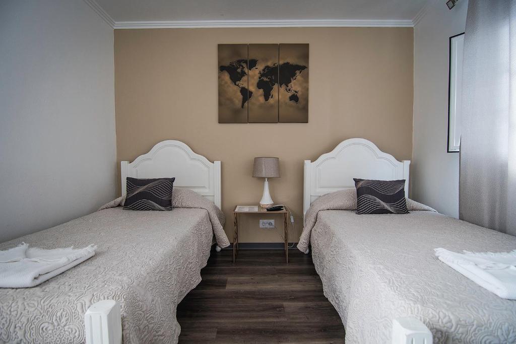 A bed or beds in a room at Casa de Hospedes Isaias