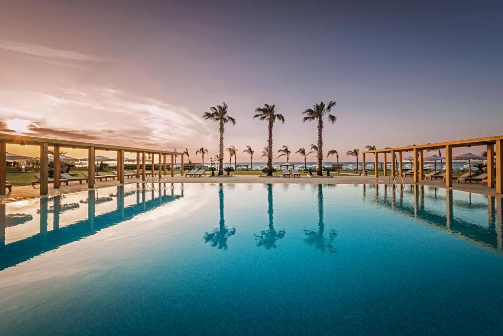 The swimming pool at or near Mitsis Alila Resort & Spa