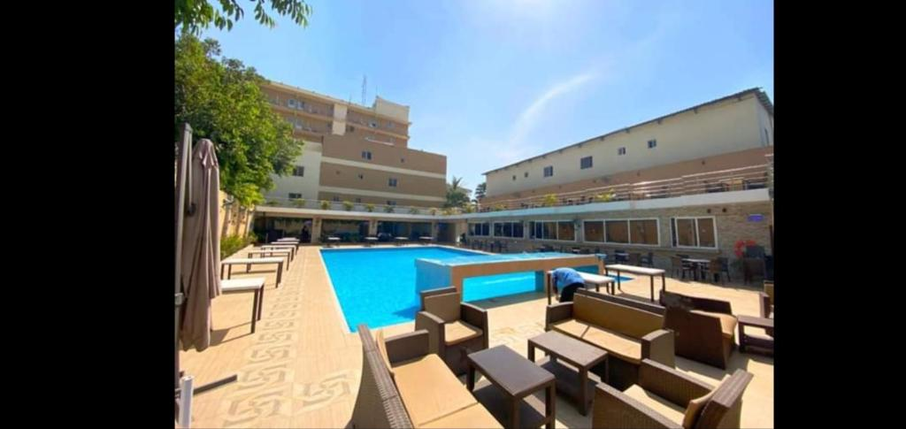 The swimming pool at or near Tahir Guest Palace