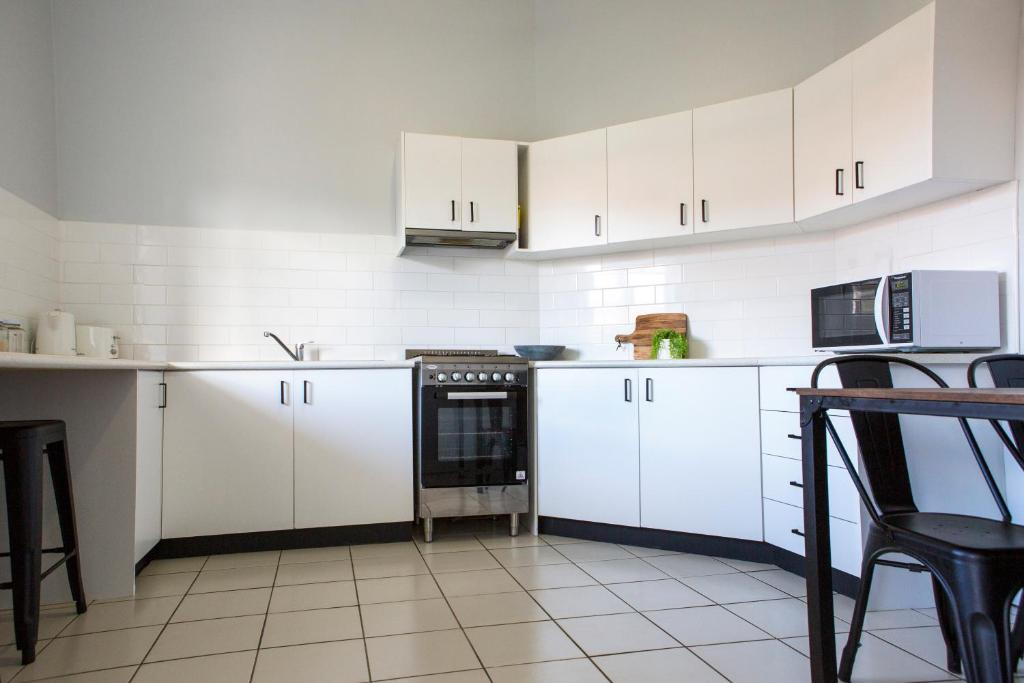 A kitchen or kitchenette at Revive Central Apartments
