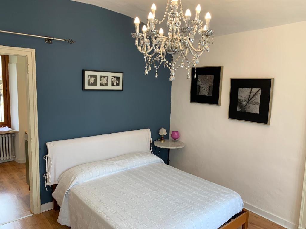 A bed or beds in a room at APPARTAMENTO a 2 minuti DALL'AEROPORTO