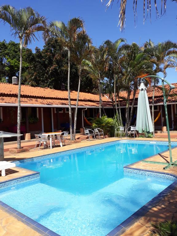 A piscina localizada em Pousada Jacare Pepira ou nos arredores