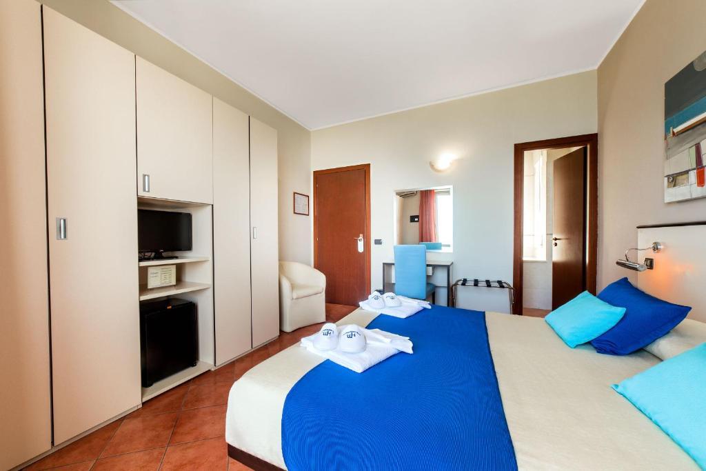 Letto o letti in una camera di Hotel Mediterraneo