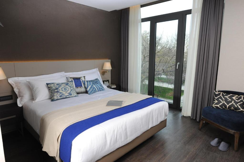 Кровать или кровати в номере Avantgarde Hotel Taksim Square