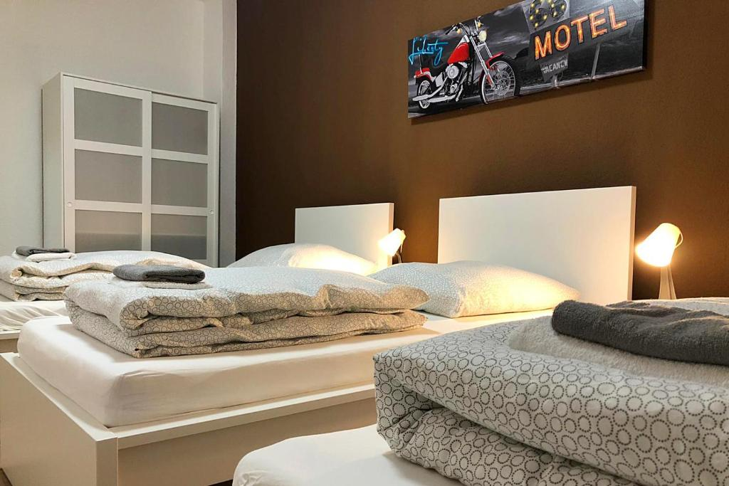 A bed or beds in a room at cosy three room apartment with flatscreen TV