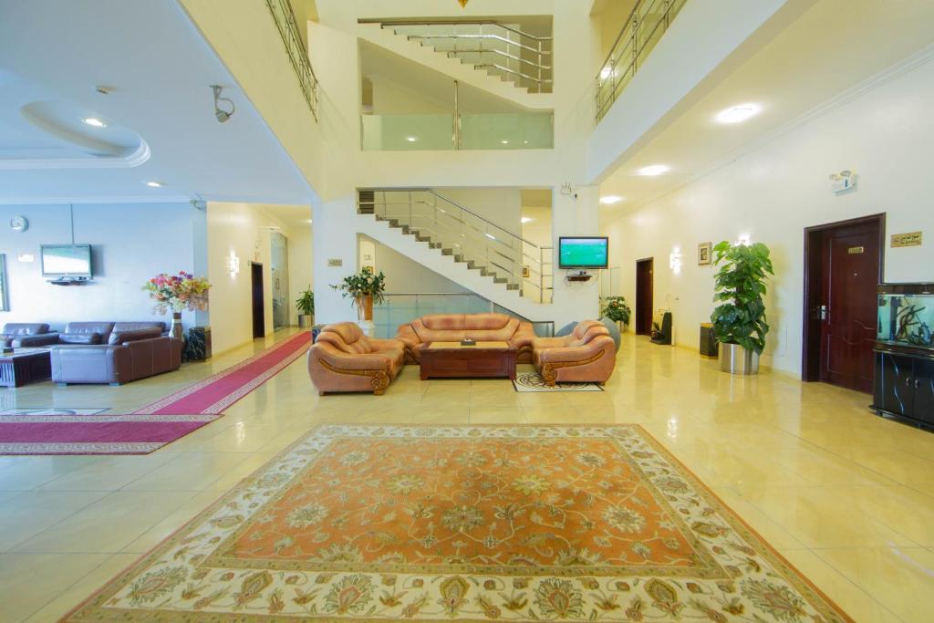 O saguão ou recepção de The New Address Hotel