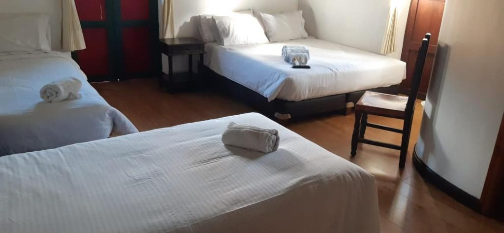 A bed or beds in a room at Mongui Plaza Hotel