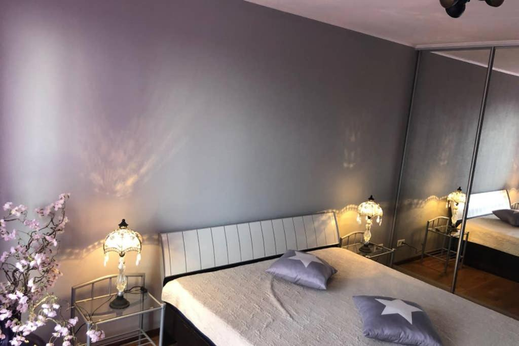 A bed or beds in a room at Prestige 1-bedroom apartment close to downtown Riga