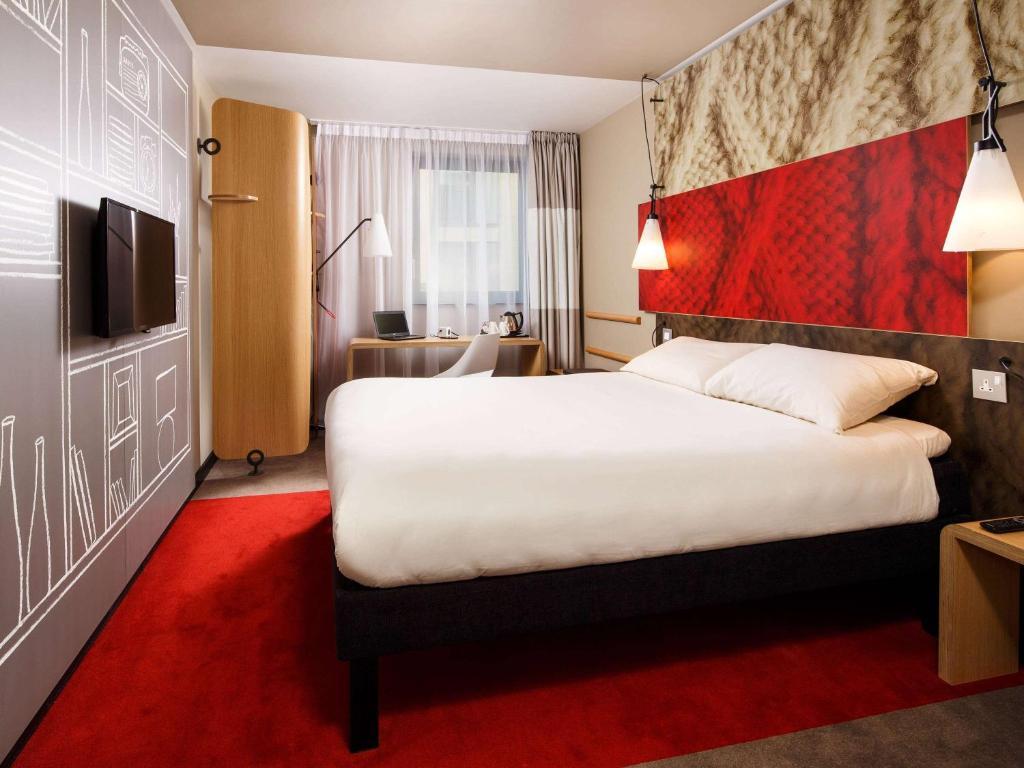 Cama o camas de una habitación en ibis London City - Shoreditch