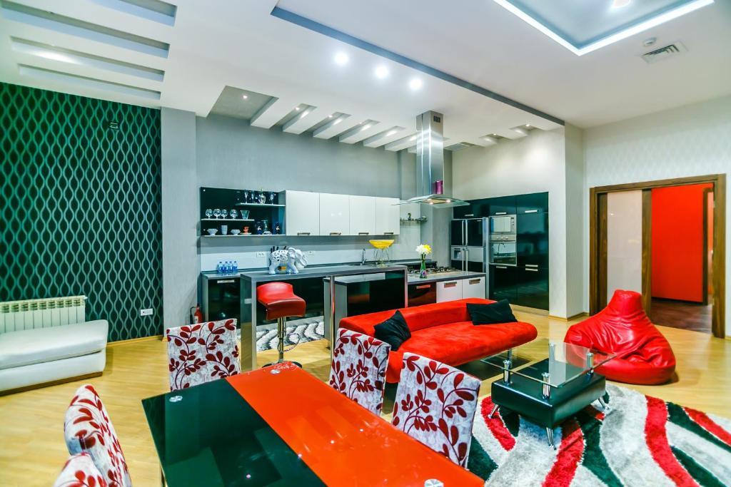Uma área de estar em Orjinal Apartment On Pakdad