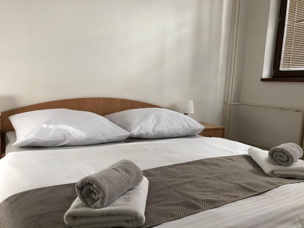 Ein Bett oder Betten in einem Zimmer der Unterkunft Šport Hotel Bôrik