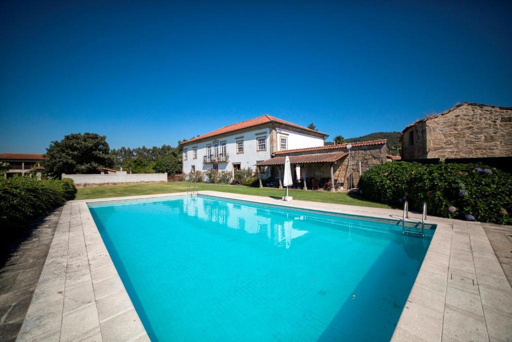 The swimming pool at or near Casa de Sta Comba