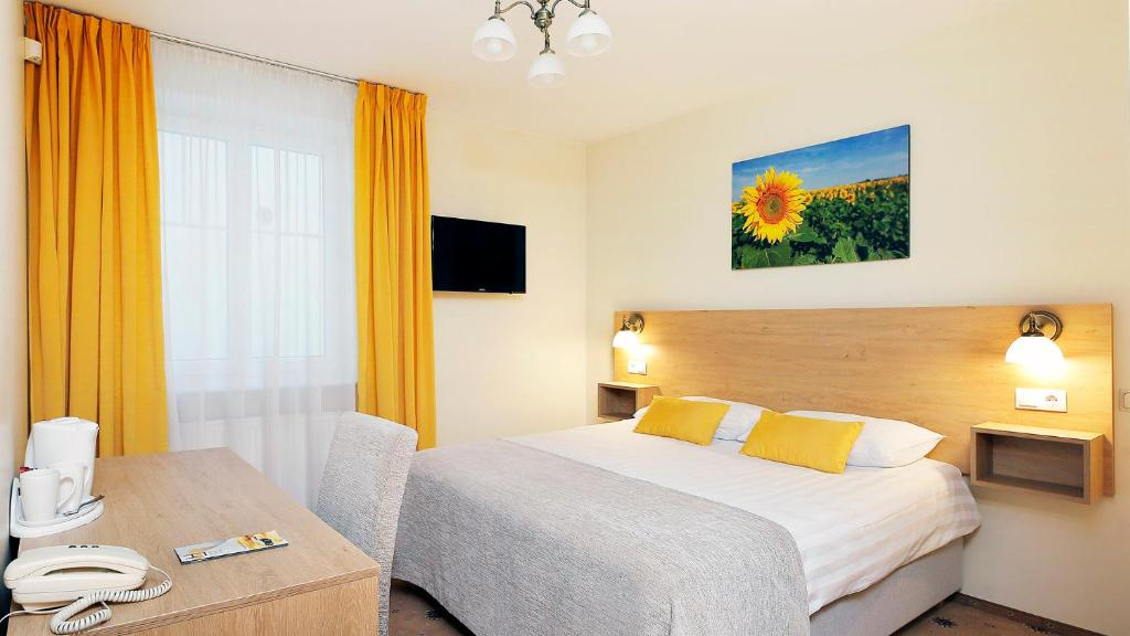 Posteľ alebo postele v izbe v ubytovaní Hestia Hotel Draugi