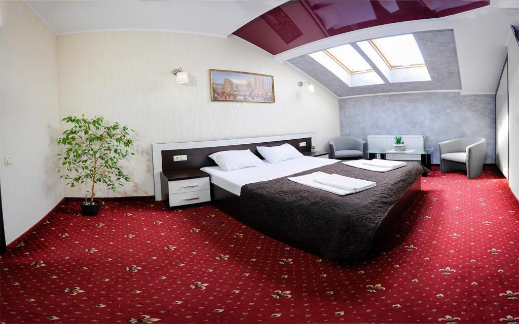 Ліжко або ліжка в номері Apartments On Zaliznychna 49