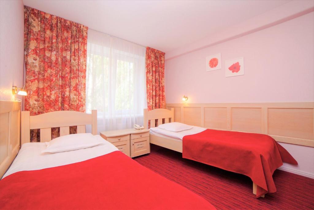 Кровать или кровати в номере Rija Hotel Tia