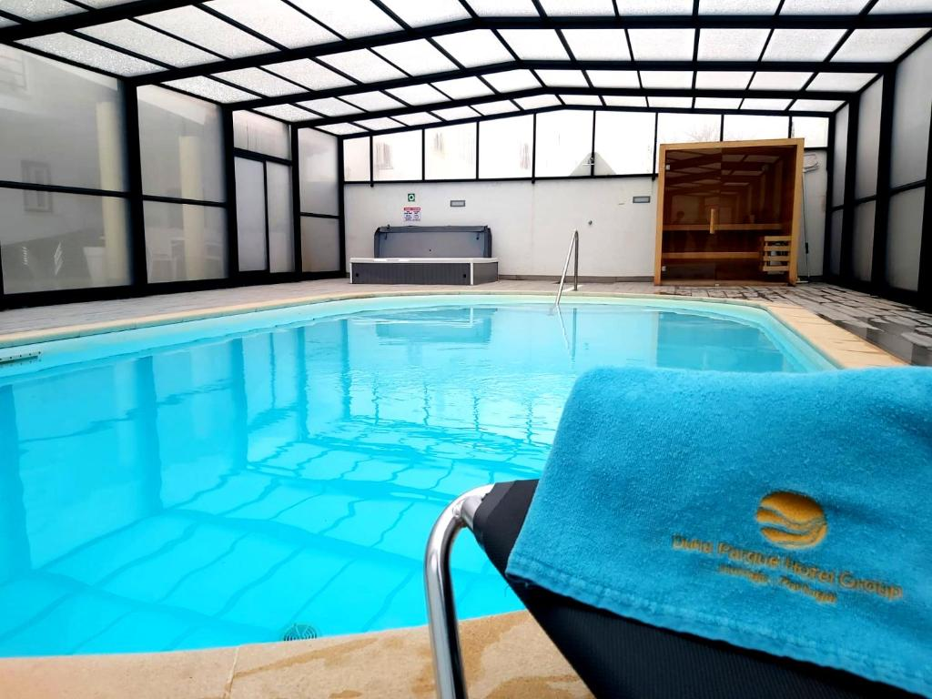 The swimming pool at or near Milfontes Bed & Breakfast - Duna Parque Group