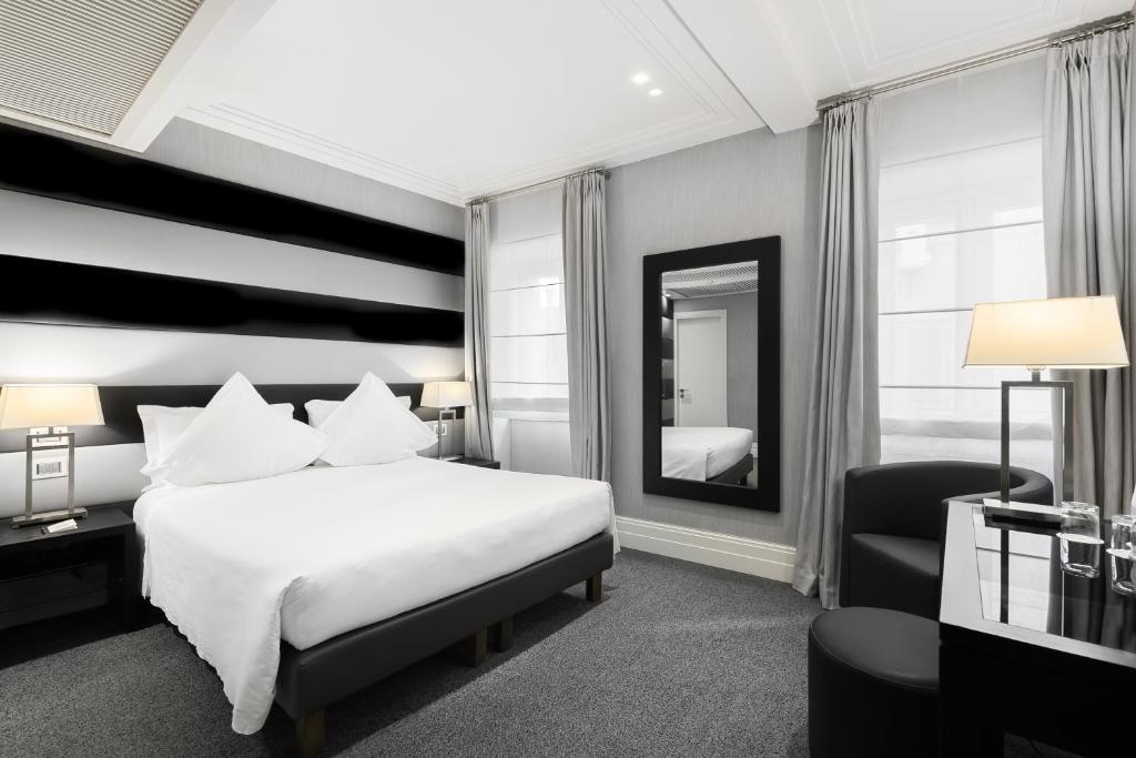 Cama ou camas em um quarto em Hotel Mancino 12