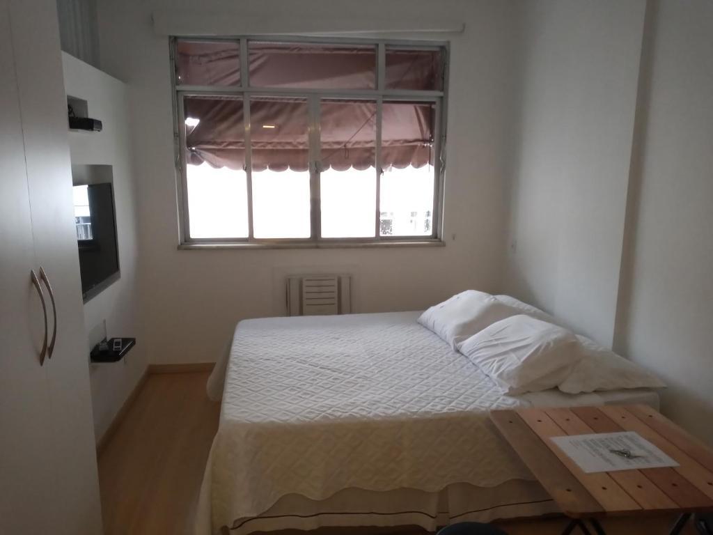 Cama ou camas em um quarto em Studio Copacabana
