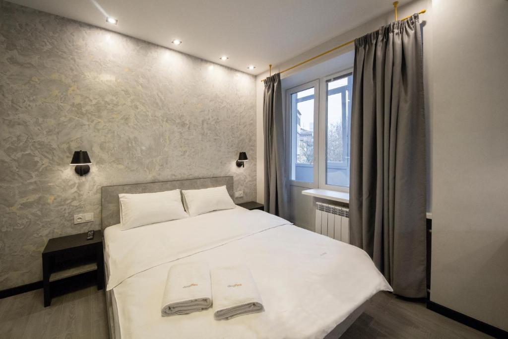 Lova arba lovos apgyvendinimo įstaigoje Modern Apartments on Baseina near Arena City