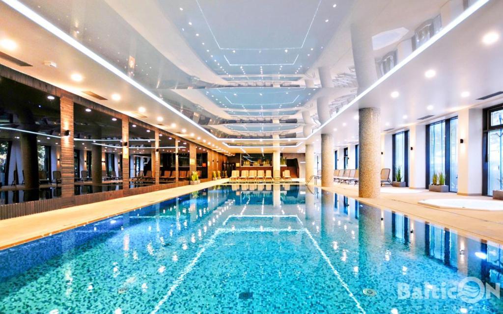The swimming pool at or close to Apartamenty BalticON Nadmorskie Tarasy