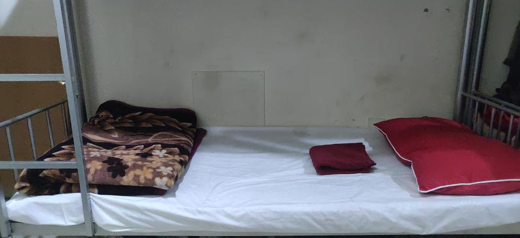 A bed or beds in a room at Welcom Tourist Hostel