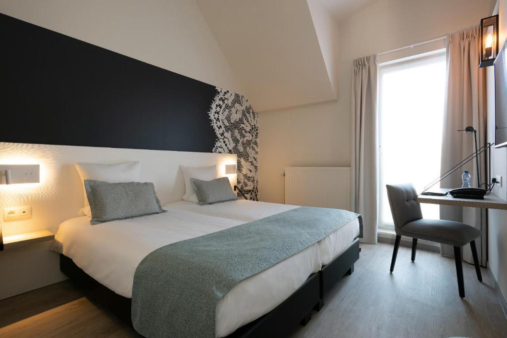 Een bed of bedden in een kamer bij Martin's Brugge