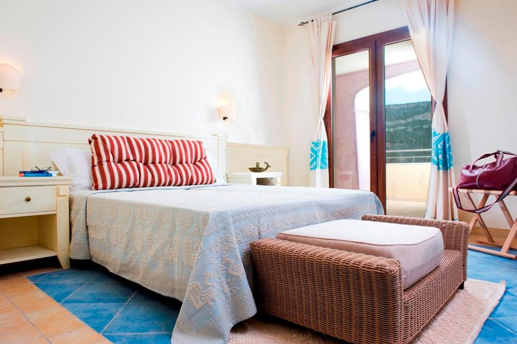 A bed or beds in a room at Hotel Baja Romantica