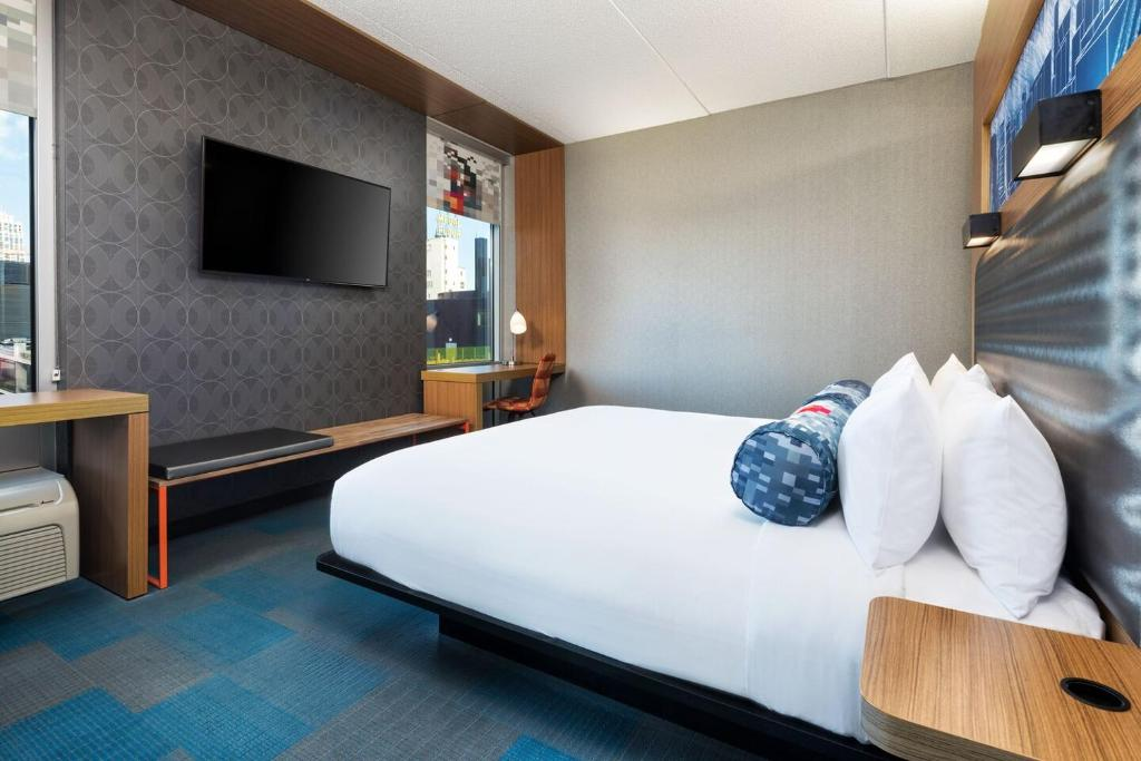 A bed or beds in a room at aloft Minneapolis
