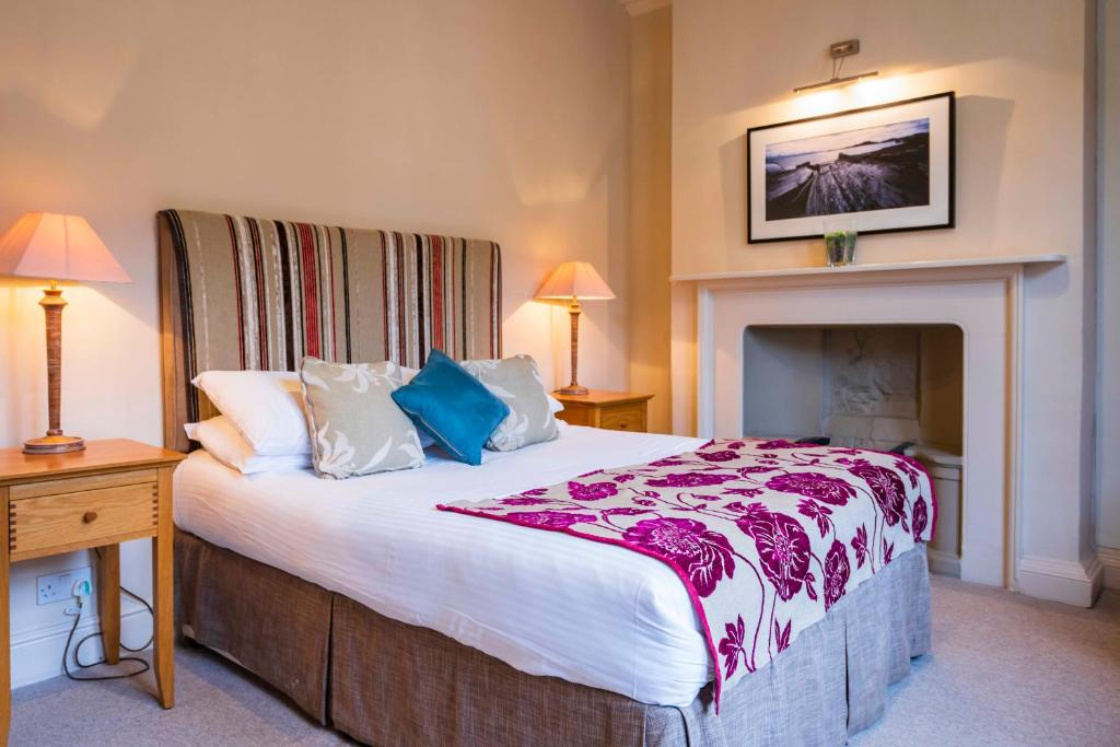 A bed or beds in a room at The Swan Hotel - Bradford-on-Avon