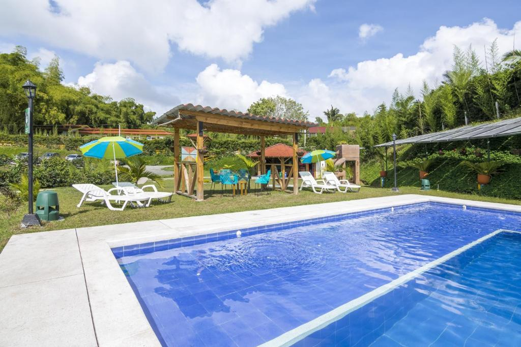 The swimming pool at or near Selina Quindio