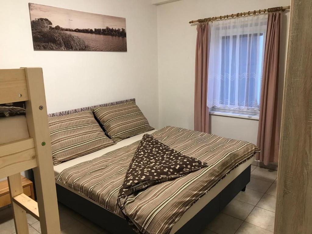 Postel nebo postele na pokoji v ubytování Ubytování Frahelž