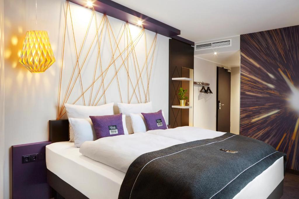 Ein Bett oder Betten in einem Zimmer der Unterkunft the niu Air