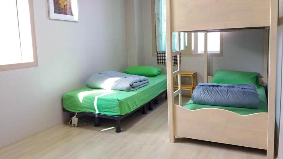 A bunk bed or bunk beds in a room at Wandonesia