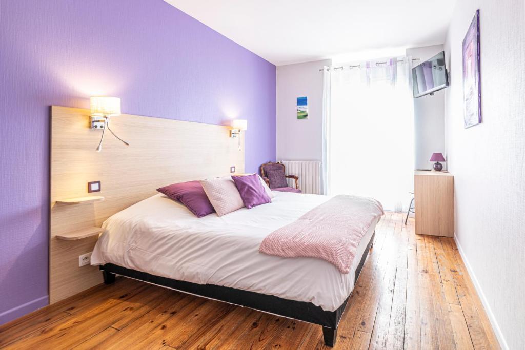 Un ou plusieurs lits dans un hébergement de l'établissement Hotel Helios - Golf